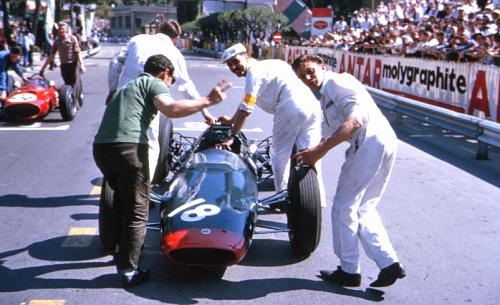 Mike Hailwood's car being pushed to the grid